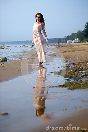 Free Beautiful Brunette In Pale Pink Long Dress Royalty Free Stock Photo - 77215095