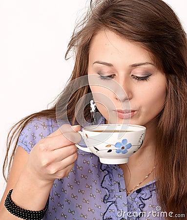 Beautiful brunette lady drinking coffee