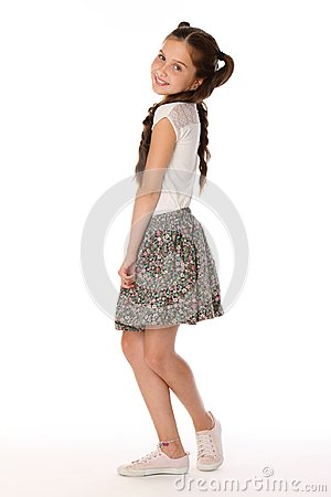 Free Beautiful Brunette Little Girl 12 Years Old Posing In A Skirt With Bare Legs Stock Photos - 112463313