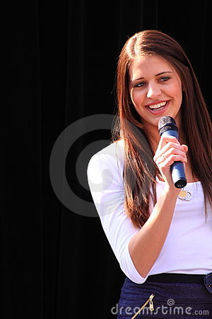 Beautiful brunette with microphone Editorial Stock Image