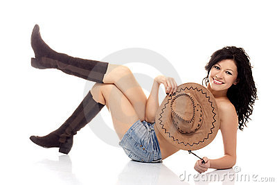 Beautiful brunette model with a cowboy hat