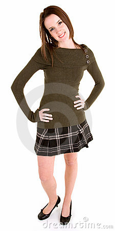 Beautiful Brunette in a Plaid Skirt and Sweater