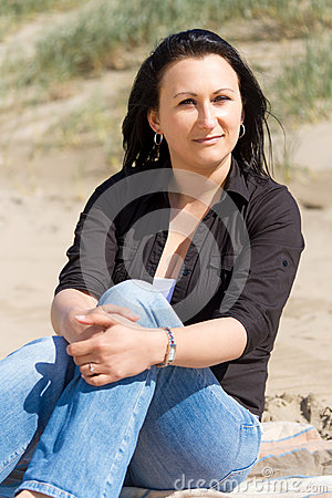 Beautiful brunette portrait on the beach