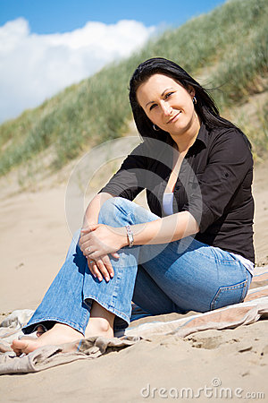 Free Beautiful Brunette Portrait On The Beach Royalty Free Stock Image - 24781286