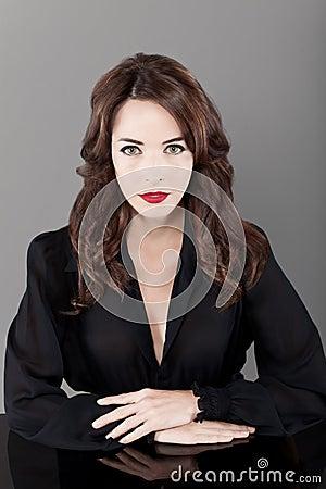 Beautiful brunette serious seductress woman
