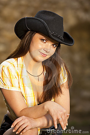 Beautiful brunette woman with cowboy hat