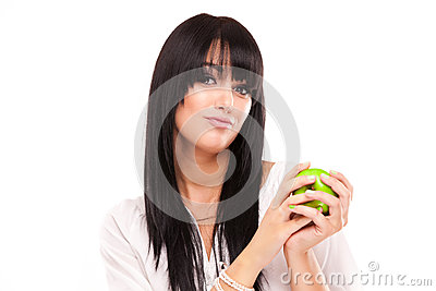 Beautiful brunette woman with green apple on white background