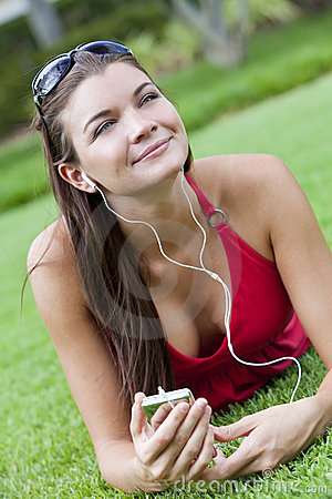 Beautiful Brunette Woman Listening to MP3 Player