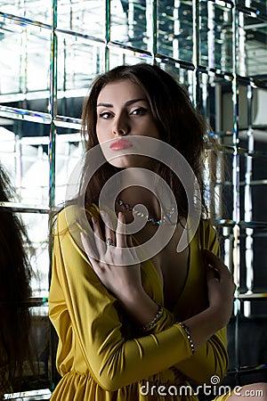 Beautiful brunette woman near mirror