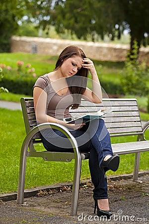 Beautiful brunette woman reading a book