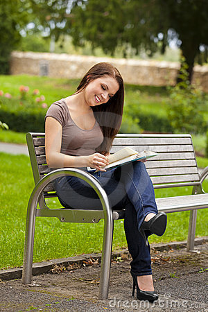 Beautiful brunette woman reading a book
