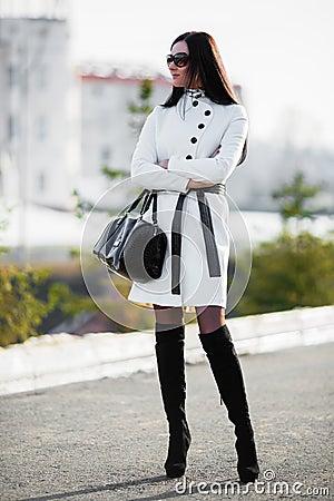 Beautiful brunette woman with reticule