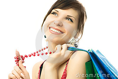 Beautiful brunette woman with shopping bags