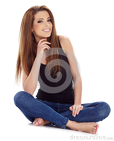 brunette woman sitting on the floor . Studio shoot.