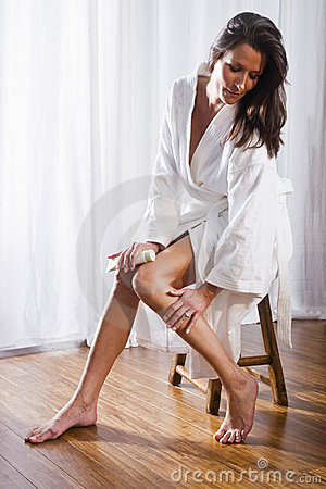 Beautiful brunette woman wearing bathrobe