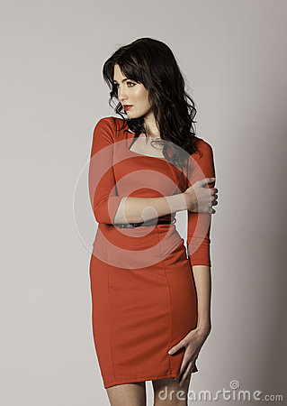 Free Beautiful Brunette Woman With Red Lips And Red Dress Looking To The Side Royalty Free Stock Image - 35642306