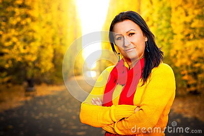 Beautiful brunette in the yellow park scenery