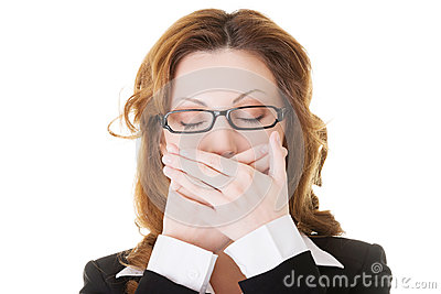 Beautiful business woman with closed eyes, covering her mouth.