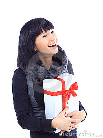 Beautiful business woman holding a gift