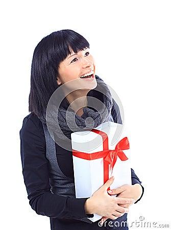 Beautiful business woman holding a gift
