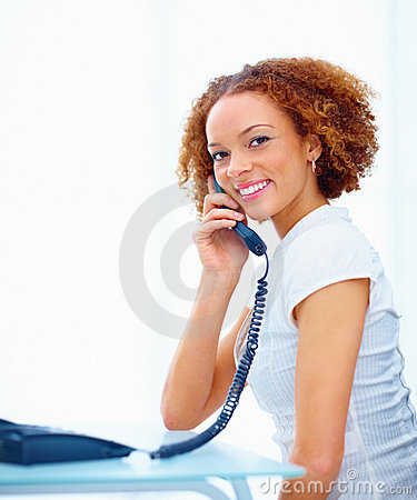 Beautiful business woman holding a telephone