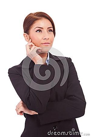 Beautiful business woman looking contemplative