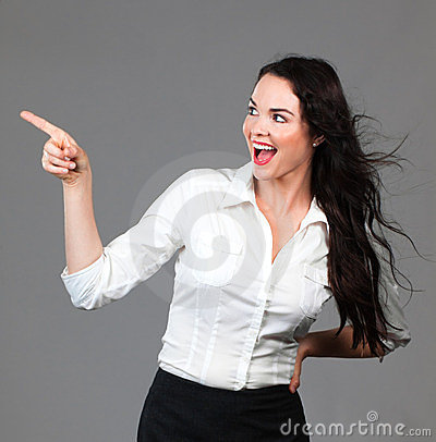 Beautiful business woman pointing at copyspace