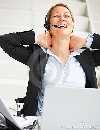 Beautiful business woman relaxing while working