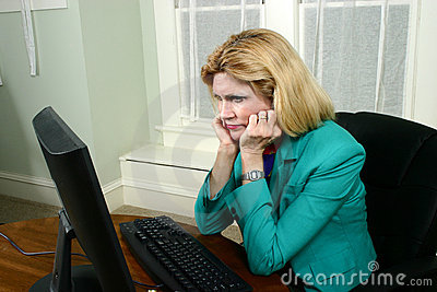 Beautiful Business Woman Stares At Computer