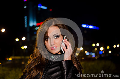 Beautiful business woman talking on a cell phone a