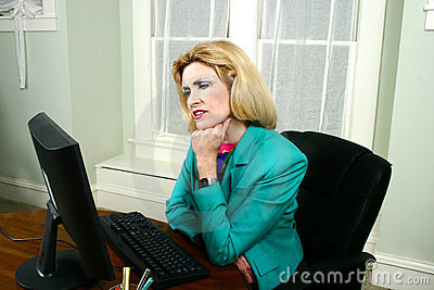 Beautiful Business Woman Thinking and Looking At Computer