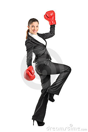 Beautiful business woman wearing boxing gloves