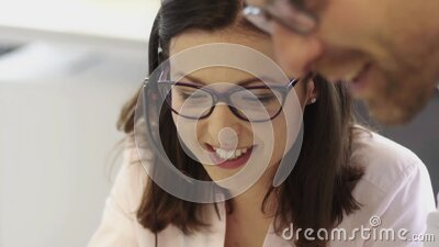 Beautiful business women wearing glasses working in call center stock footage