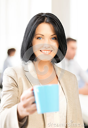 Beautiful businesswoman with cup of coffee