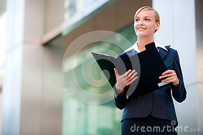 A beautiful businesswoman holding a clipboard