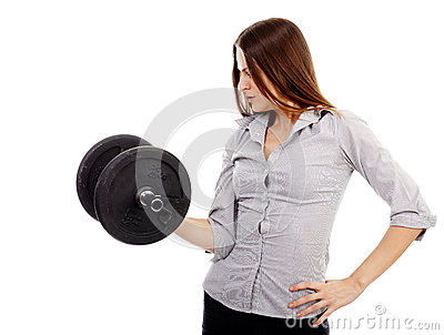 Beautiful businesswoman lifting a dumbell