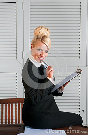 Beautiful businesswoman with paper
