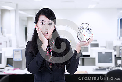 Beautiful businesswoman shock at deadline clock