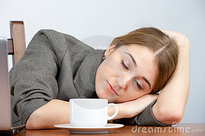 Beautiful businesswoman sleeping at