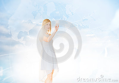 Beautiful Businesswoman Touching Screen With World Map In Backgr