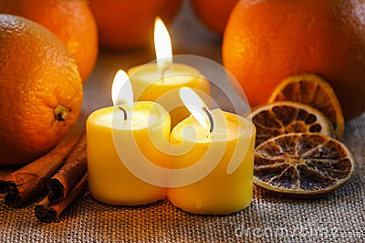 Beautiful candles and juicy oranges