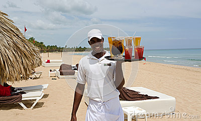 Beautiful Caribbean beach and local waiter Editorial Stock Photo