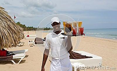 Beautiful Caribbean beach and local waiter Editorial Stock Photo