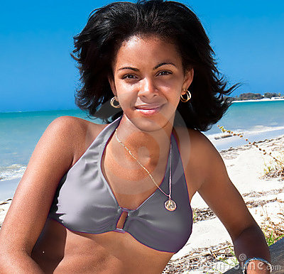 Beautiful caribbean  woman on tropical beach