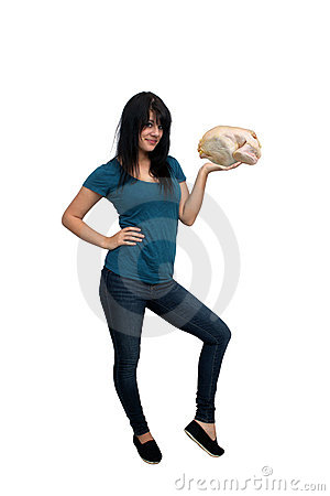 Beautiful Casual Brunette Holding a Raw Chicken