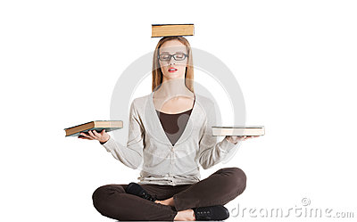 Beautiful casual woman sitting with books on palms and head, doi