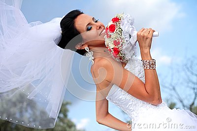 Beautiful caucasian bride with bouquet