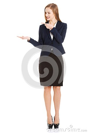 Free Beautiful Caucasian Business Woman Pointing On Copy Space On Her Side. Royalty Free Stock Photography - 123177757