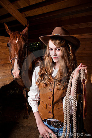 Free Beautiful Caucasian Cowgirl With A Horse Stock Images - 10395694