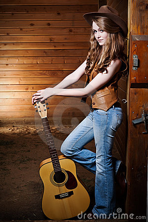 Free Beautiful Caucasian Cowgirl With Guitar Royalty Free Stock Images - 10820279